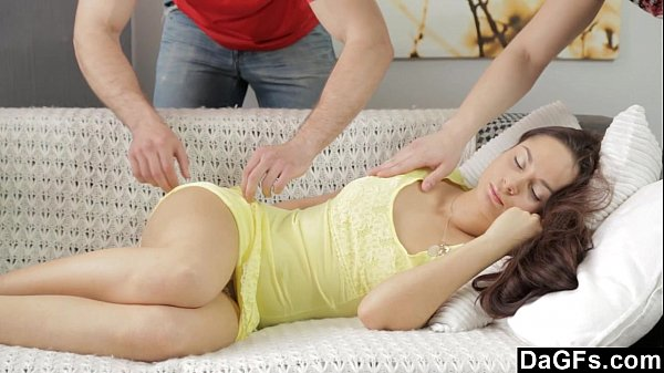 Beautiful brunette banged by her two roommates on the couch